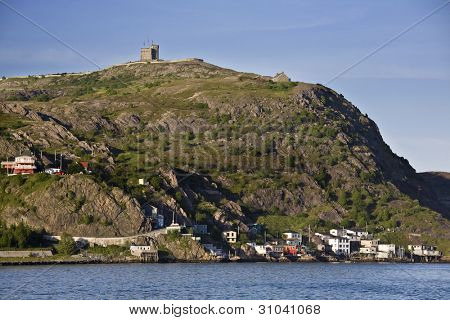 Cabot tower on the top of Signal Hill and the residential area of the Lower Battery on the lower slopes are located in St. John's, Newfoundland.