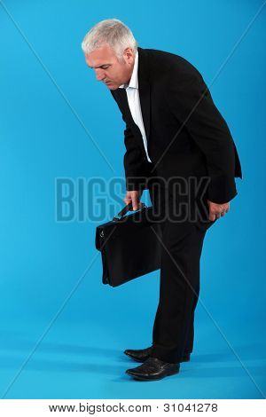 Middle-aged businessman with briefcase