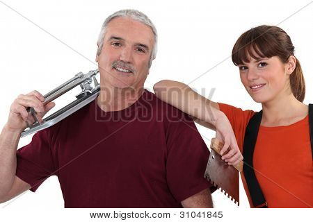 Tile cutter with female colleague