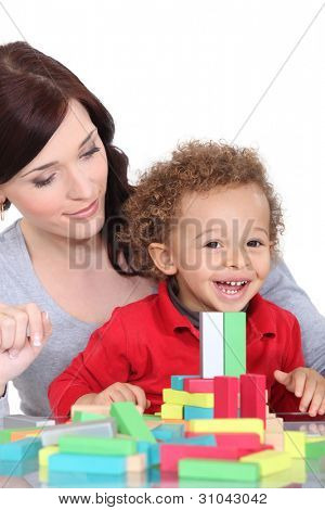 Mother and son with colourful building blocks