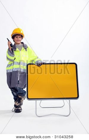 Boy dressed up as a traffic guard