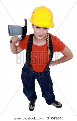Female laborer holding blowtorch