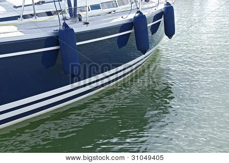 Blue Motorboat On Calm Water
