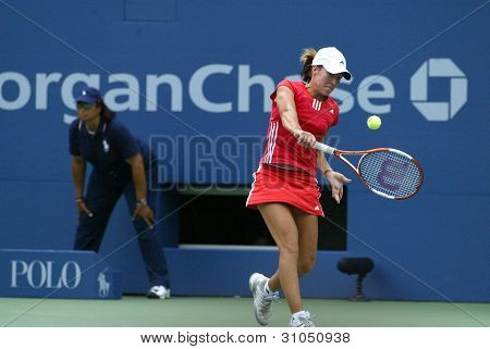 FLUSHING - AUGUST 30: Justine Henin-Hardenne of Belgium hits to Zuzana Ondraskova of the Czech Republic during the U.S. Open at Arthur Ashe Stadium on August 30, 2005 in Flushing Meadows-Corona Park.