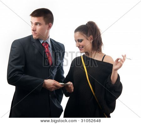 Worried young businessman giving money to the lady of questionable moral