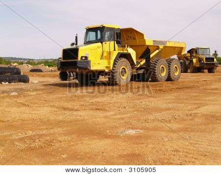 Yellow Dump Truck At A Construction Site