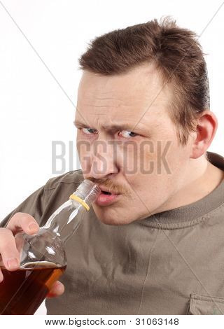Color photo of a man with a bottle of whiskey
