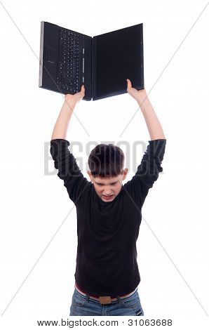Angry teenage boy throwing laptop isolated on white