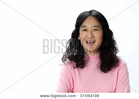 A Beautiful Mature Asian Lady Laughs Joyfully in Surprise