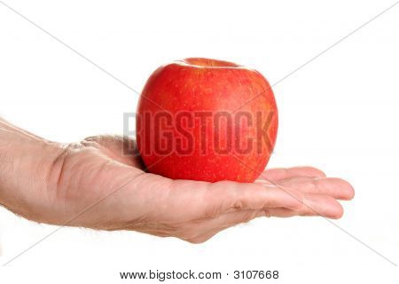Man Holding Delicious Red Apple