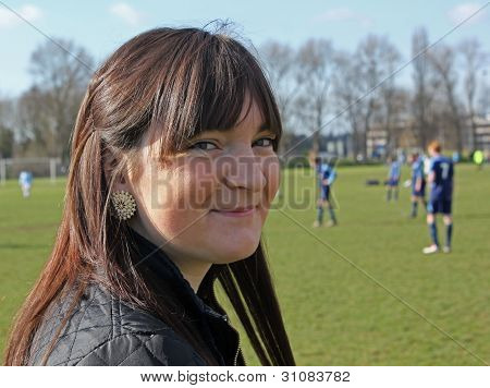beautiful girl watching footbal game
