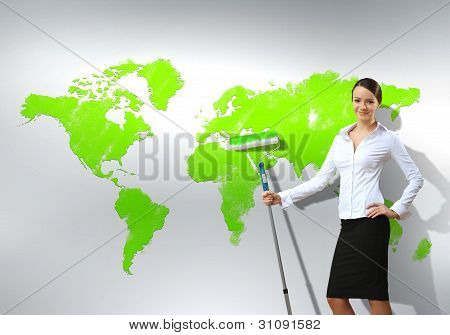 Businesswoman with paint brush and world map