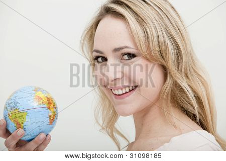 Blonde Woman Holding A Globe