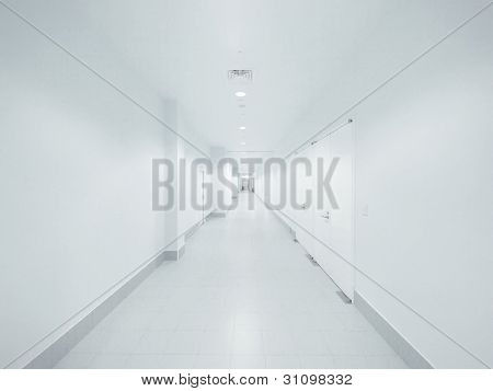 Long walkway and white wall