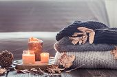Cozy Autumn Still Life With Candles And A Sweater poster