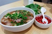stock photo of tripe  - Vietnamese Rare Beef Noodle Soup Pho Chilli Basil