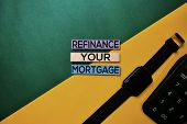 Refinance Your Mortgage Text On Top View Color Table Background. poster