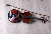 Classical Violin Isolated On Wooden Background. Studio Shot Of Old Violin. Classical Musical Instrum poster