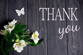 White Flowers Of Alstroemeria On A Dark Wooden Background With An Inscription Thank You. Thank You W poster