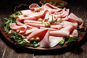 Sliced Ham On Wooden Background. Fresh Prosciutto. Pork Ham Proscuitto Sliced. poster