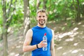Healthy Lifestyle. Refreshing Drink. Man Athletic Sportsman Hold Bottle Water. Athlete Drink Water A poster