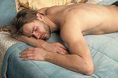 Lost A Deep Sleep. Handsome Man Having Sleep In Bedroom. Sleeping Man In Morning. He Needs More . Se poster