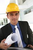 stock photo of hard_hat  - A handsome business construction man on the work site - JPG