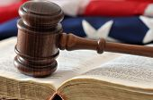 stock photo of justice law  - Gavel flag and book in a portrayal of judicial system - JPG