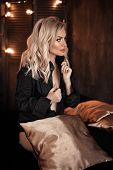 Hairstyle. Beautiful Blonde Woman Portrait Posing In Black Shirt.  Fashionable Blond Girl Model Over poster