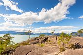 A Wilderness Landscape In Norway At The Geiranger Fjord In Summer With A Blue Sky And White Clouds A poster