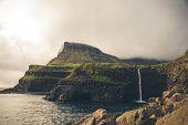 Gasadalur Village And Beautiful Waterfall. Vagar, Faroe Islands, Denmark. poster