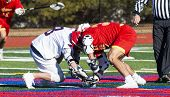 Two Boys Fight For The Ball During The Faceoff Of A High School Lacrosse Game. poster
