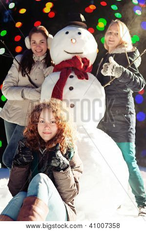 Girls And Snowman