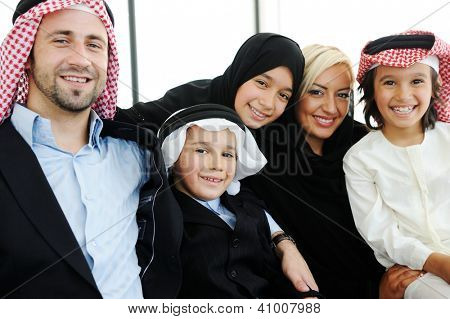Arabic Muslim father and mother with sons daughter