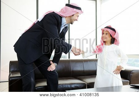 Middle eastern Muslim business people with children at office