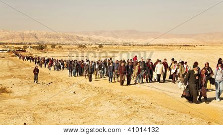 JORDAN VALLEY, ISRAEL - JANUARY 18: Day of a sacred Christening of Jesus  with going pilgrims. January 18, 2008, Jordan valley, Israel. 5 km north of the Jordan River flows into the Dead Sea
