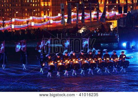 MOSCOW - SEPTEMBER 4: Secret Corps of drummers of Switzerland with illuminated drumsticks at Military Music Festival Spasskaya Tower on September 4, 2011 in Moscow, Russia.