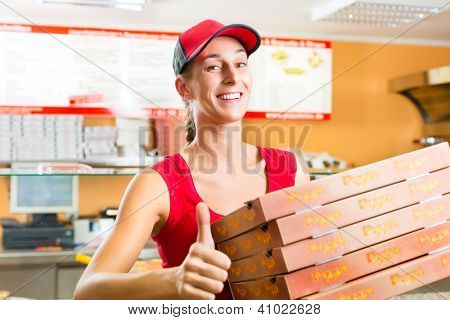 Woman holding several pizza boxes in hand and asking you to order pizza for delivery