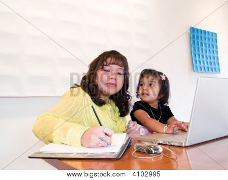 Native American Woman Working With Her Daughter