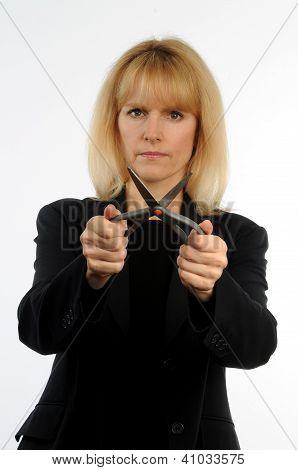Concept photo female executive holding scissors representing corporates cuts