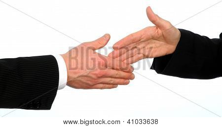 Closeup of male and female executives about to shake hands