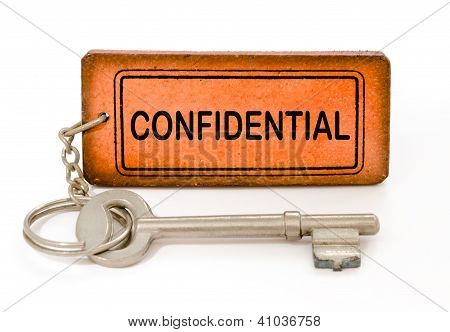 Old Key With Confidential Leather Tag Isolated White