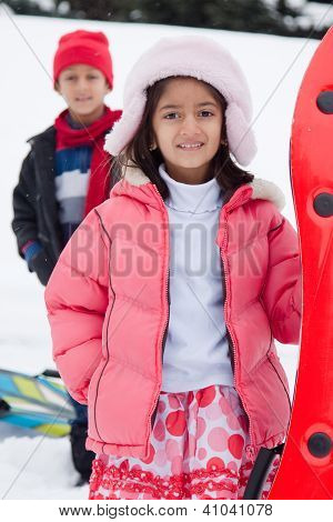 East Indian Kids Toboganning In The Snow