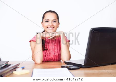 Happy Beautiful Young Business Woman Sitting At Office Desk