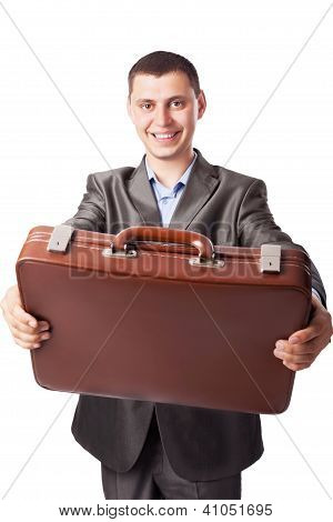 Young Businessman Holds A Brief Case Isolated On White Background