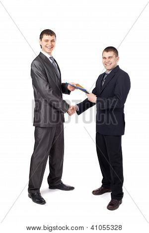 Handshake Of Business Partners, When Signing Documents Isolated On White Background