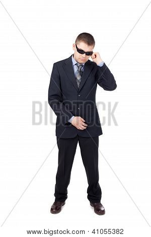 Security Guard Wearing A Suit And Sunglasses Isolated On White Background