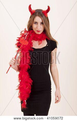 Girl dressed in devil costume