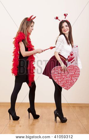 two girls acting angel and devil
