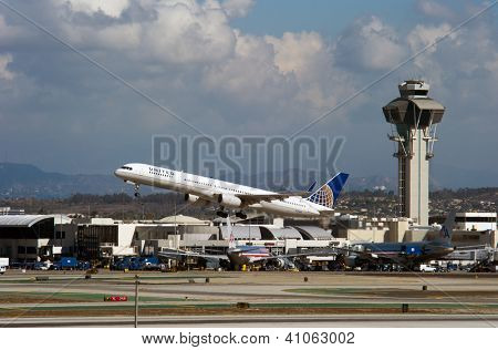 LOS ANGELES, CA - OCTOBER 23: A United Airlines passenger jet takes off from Los Angeles International Airport (LAX) in Los Angeles, CA on October 23, 2012. United is the largest airline in the world.